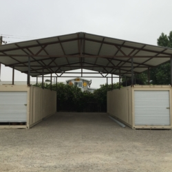 Shipping containers creating car port
