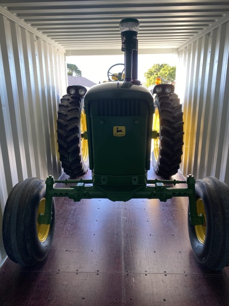 Tractor in shipping container storage
