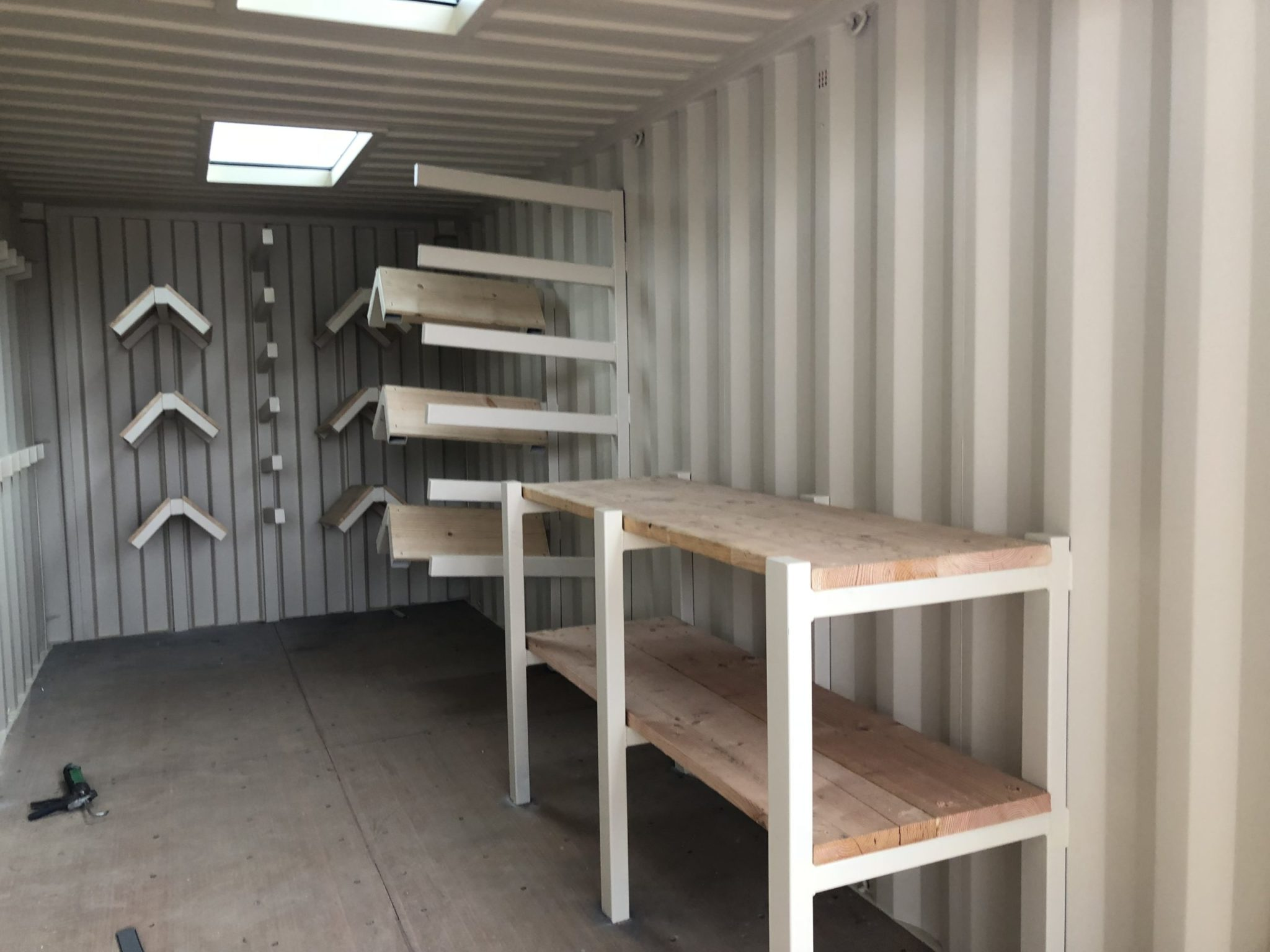 Shipping container with customized work bench