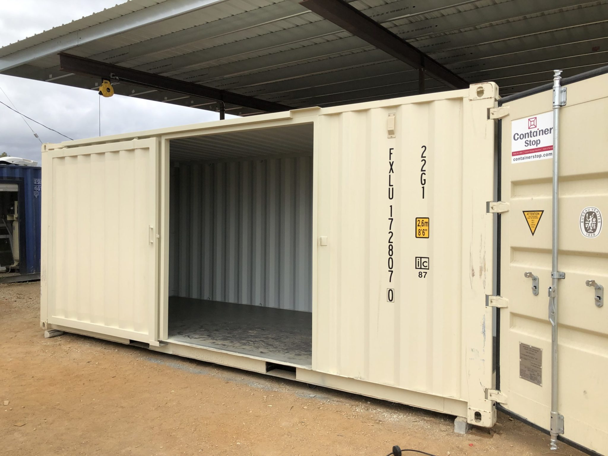 Shipping container with custom door
