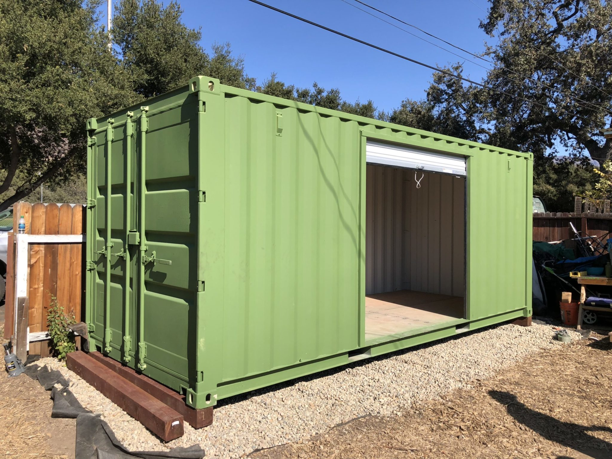 Green Shipping Container with custom garage door