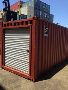 Storage container San Luis Obispo - red container with roll up door in Container Stop yard